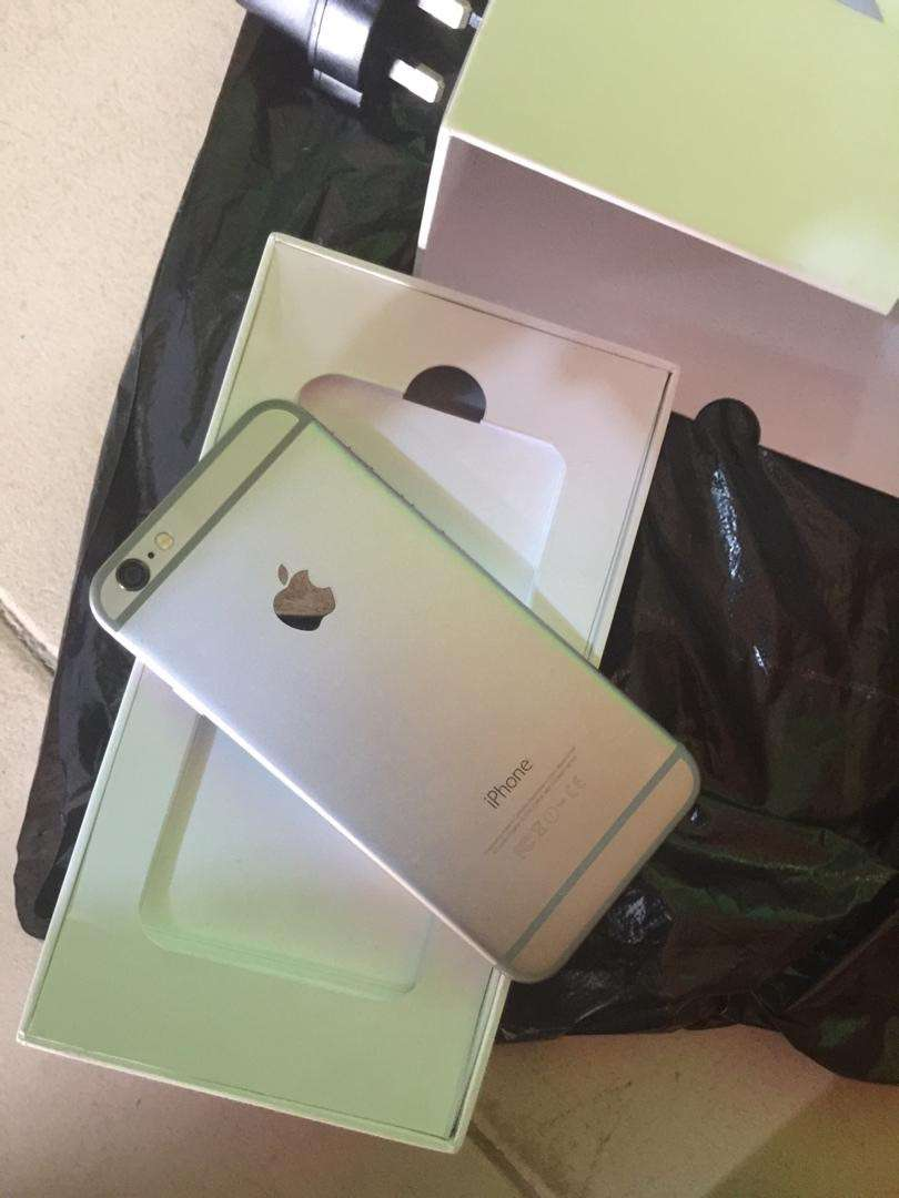 New iPhone 6 very neat with charger 64gb 0