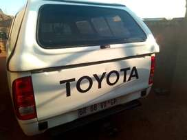 Toyota Hilux bakkie with canopy and white