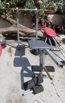 Weight lifting bench with weights