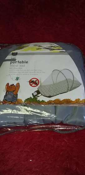 Portable travel bed with mosquito net