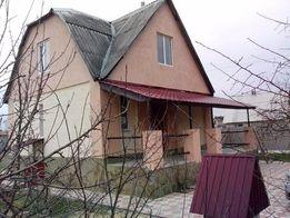 продам заміський будинок