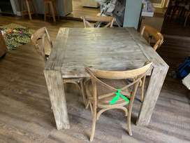 Wooden four seater table and chairs