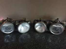 2 x sets of OEM BMW e30 / e34 Hella smiley headlights for sale