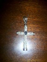 Продам крестик серебряный с золотыми вставками.