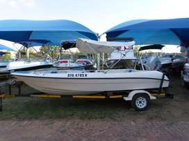 Escape 17 with 115hp Mariner outboard motor.