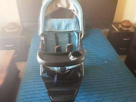 Baby strap belt , cup holder , brakes button and  space for towels