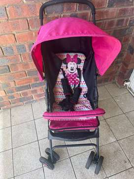 Selling my pram that is black and pink in color, it In good condition