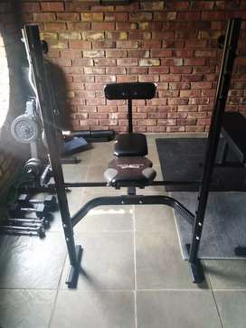Adjustable Bench press with squat rack and a preacher curl mechanism
