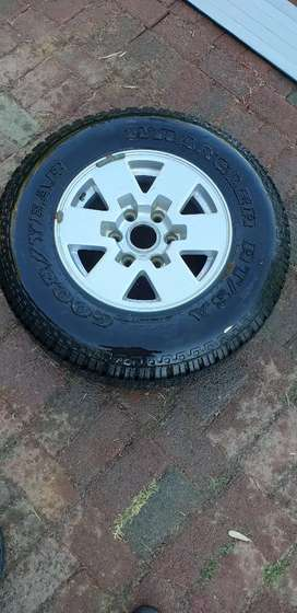 15 inch mag rim and goodyear tyre 215R15C