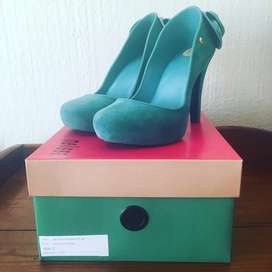 Green heels with bow detail by Melissa (size Eur 38)
