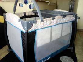 BOUNCE cot in new condition.will even give the matress, pillow an  mos