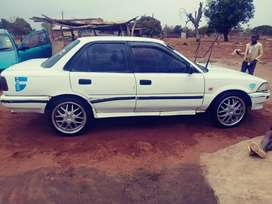 White corolla on stable condition
