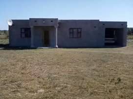 It has a big yard has electricity and close to town