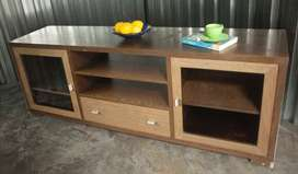 A cabinet used for TV stand and lounge lights. Two glass   door sectio