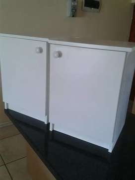 Two white bedside tables with doors for sale 280 each