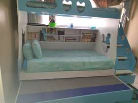 Blue Triple bunk bed.Almost Brand new. Extra storage