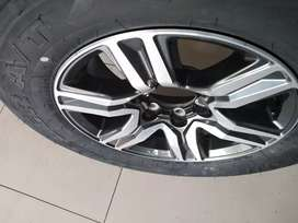 """1 x 17"""" Toyota Fortuner mag rim and a tyre for spare wheel."""