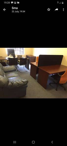 Two seater office desk with a divider