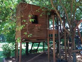 Wooden Treehouse with swing, gangway and slide