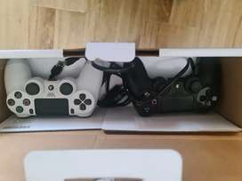 1TB PS4 console with 2 controllers