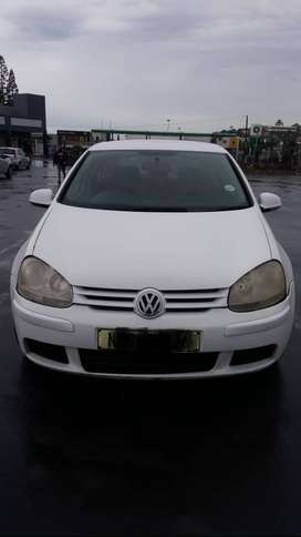White golf 5 needs little attention  it a daily used car