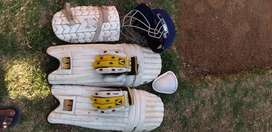 GM HELMET, IHSAN PADS, BAS GLOVES AND 4 BALL BOXES (USED)