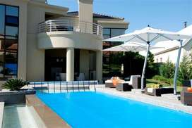 Swimming pool safety nets and covers