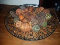 Image of Wire basket with seeds and grass balls