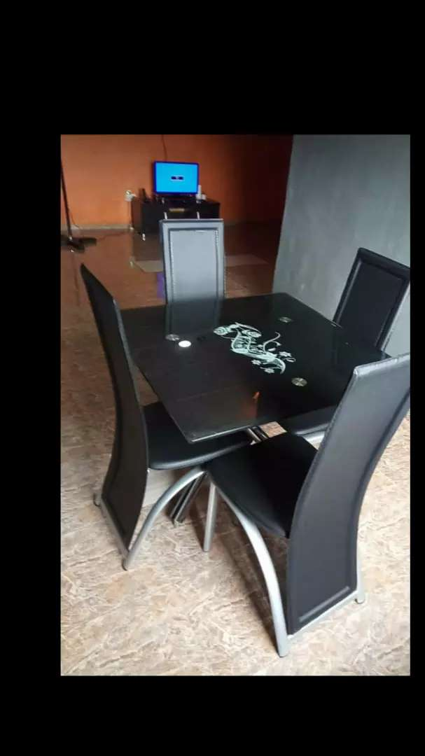 By four dining table with four chairs 0