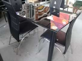 Brand new Glass Dining tables with 4 chairs of excellent quality.