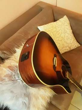 Selling  a Guitar still new plus its bag good condition