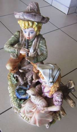 Boy playing Flute and Girl with Lamb Ceramic Figurine - Crown N Marked
