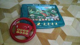 Interaktywna tablica dinozaury, drewniane klocki oraz kierownica