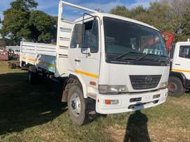 2008 Nissan UD80 Dropside with 8Meter Body