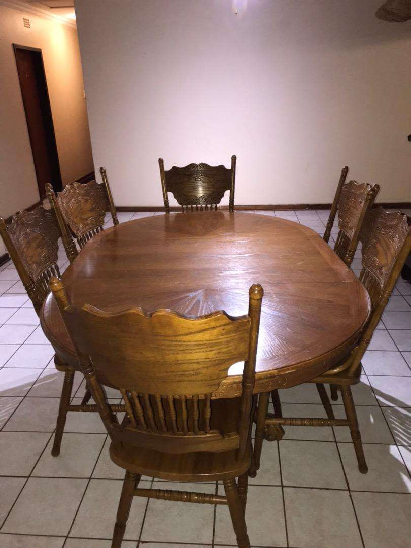 Oak dining table and chairs 0