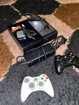 Xbox 360 with 1 game and 2 remotes