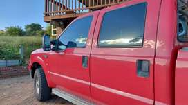 F250 Double cab truck, red ,2006 model