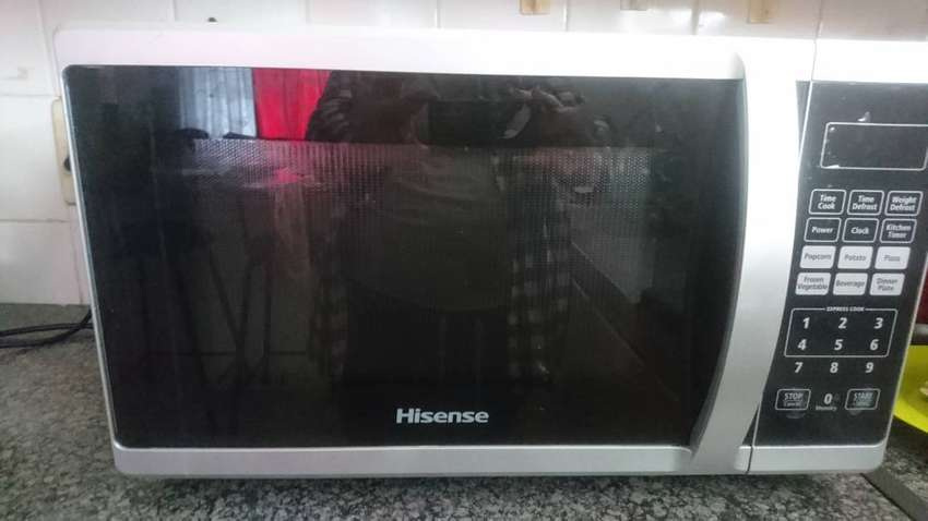 Hisense silver and black featured microwave. Less than one year old. 0