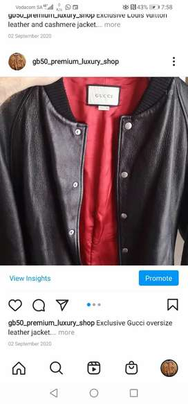 Gucci oversize leather jacket with tiger embroidery