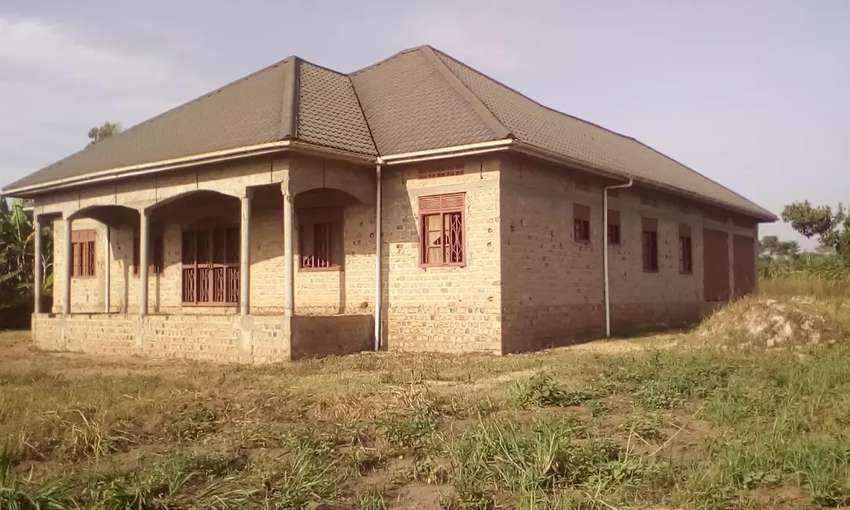 Six bedroom house with two garages on one acre for sale in Kasangati 0