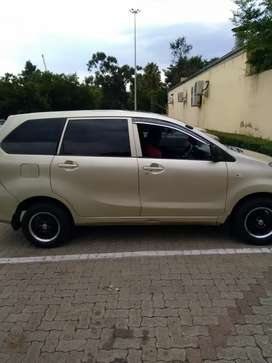 Toyota Avanza 1.3 with sunroof gold in colour