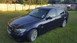 BMW 323i exclusive pack, navigation and voice control.