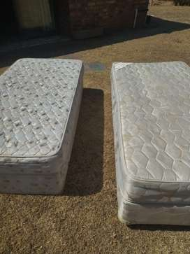 Beds,ie. Two single mattresses with matching bases