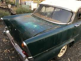Vintage Vauxhall car with papers restoration project