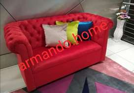 New red velvet button couch
