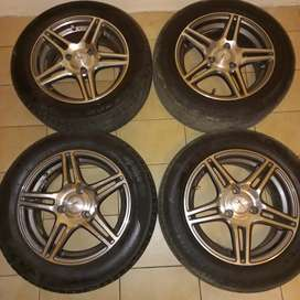 Aline 14 inch 3 stud mags with new tyres