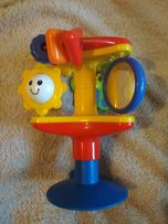 Музыкальная развивающая игрушка на столик для кормления