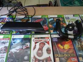 Xbox 360 games plus steering wheel and Kinect for sale
