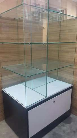 Glass display cabinet with storage drawer