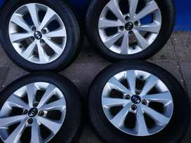 A set of 15inch  mags and tyres for Kia Rio
